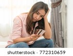 stressed young asian woman... | Shutterstock . vector #772310659