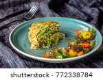 zucchini pancakes with salad at ... | Shutterstock . vector #772338784