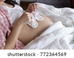 pregnant woman relaxing at home ... | Shutterstock . vector #772364569