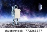 spaceman with banner. mixed...   Shutterstock . vector #772368877