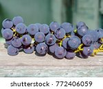 A Ripped Bunch Of Red Grapes...