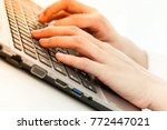 hands placed on the notebook...   Shutterstock . vector #772447021