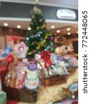 Small photo of Blurred scence of decorative christmas tree with hamper sale for new year gift at the supermarket