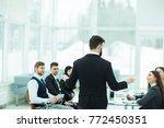 ceo speaks at the workshop... | Shutterstock . vector #772450351