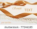 gold satin ribbon on decorative ... | Shutterstock . vector #77246185