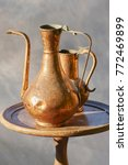 Small photo of old copper pitcher at garage sale