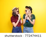 two happy hipster girls with... | Shutterstock . vector #772474411
