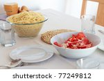 Dinner plates - pasta and salad - stock photo
