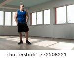 handsome young man standing... | Shutterstock . vector #772508221