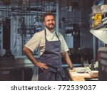smiling cook in the kitchen | Shutterstock . vector #772539037