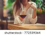 young girl with a glass of wine | Shutterstock . vector #772539364