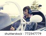smiling female pilot in the... | Shutterstock . vector #772547779