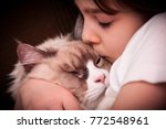 autistic girl with her siberian ... | Shutterstock . vector #772548961