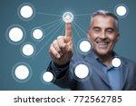 smiling businessman using a...