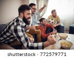 happy friends or football fans... | Shutterstock . vector #772579771