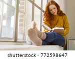 Young Red Haired Woman Reading...