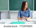 happy smiling female teacher or ... | Shutterstock . vector #772599805