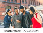 multiracial friends using a... | Shutterstock . vector #772610224