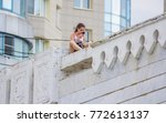 the girl sits on the... | Shutterstock . vector #772613137
