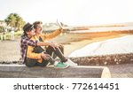 happy gay couple taking selfie... | Shutterstock . vector #772614451
