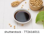 soy sauce and soy bean on... | Shutterstock . vector #772616011