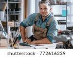 happy craftsman after... | Shutterstock . vector #772616239