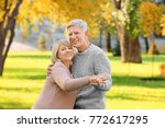 cute elderly couple dancing in... | Shutterstock . vector #772617295