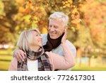 cute elderly couple in autumn... | Shutterstock . vector #772617301
