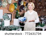 happy woman posing with ceramic ... | Shutterstock . vector #772631734