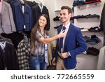 girl seller helps to pick up a...   Shutterstock . vector #772665559