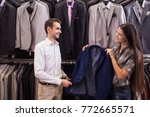 girl seller helps to pick up a...   Shutterstock . vector #772665571