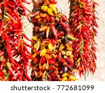 mixed peppers hanging being sun ... | Shutterstock . vector #772681099