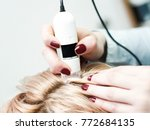 hair doctor checking hair.... | Shutterstock . vector #772684135