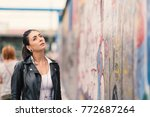 young woman looking at berlin... | Shutterstock . vector #772687264