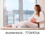 portrait of expecting mother....   Shutterstock . vector #77269216