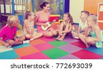attentive kids sitting around... | Shutterstock . vector #772693039