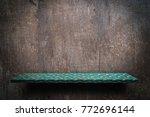 green metal shelf display... | Shutterstock . vector #772696144