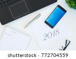 high angle shot of items on a... | Shutterstock . vector #772704559