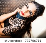young sexy woman with leopard...   Shutterstock . vector #772706791