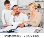 chagrined man sitting at home... | Shutterstock . vector #772721521
