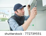 handyman removing filter from a ... | Shutterstock . vector #772739551