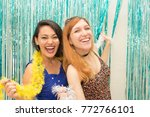 two women  one caucasian and...   Shutterstock . vector #772766101