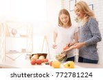 mom and daughter are cooking... | Shutterstock . vector #772781224