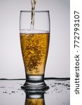 pouring light beer into...   Shutterstock . vector #772793107