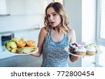 hard choice. yound sporty woman ... | Shutterstock . vector #772800454