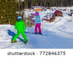 "Small photo of ""Gornaya Salanga"", Russian Federation - February 22, 2017. Active kids with a protective helmet, glasses and skis. A lesson for children in an alpine school. A small skier in the snow"