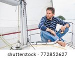 man in a striped sweater and... | Shutterstock . vector #772852627