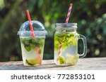 Small photo of Zero waste concept Use a plastic glass or mason jar. Zero waste, green and conscious lifestyle concept. Reusable on the go drink container ideas.