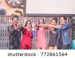 group friends enjoying party... | Shutterstock . vector #772861564