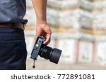 male photographer  hand hold... | Shutterstock . vector #772891081